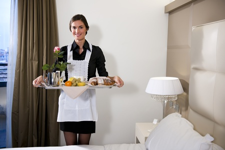 breakfast hotel: Happy Maid Carrying Breakfast Tray
