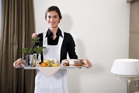 hotel room: Happy Maid Carrying Breakfast Tray