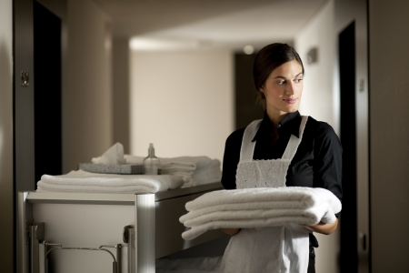 hotel service: Maid with housekeeping cart Stock Photo