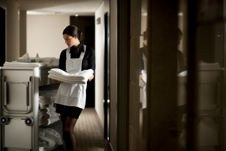 Maid with housekeeping cart Stock Photo - 9319550