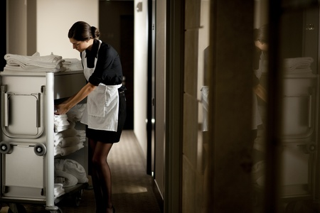 Maid with housekeeping cart Stock Photo