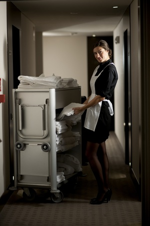 Maid with housekeeping cart Stock Photo - 9319556