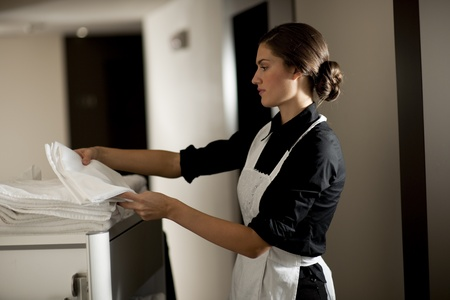 cleaning service: Maid with housekeeping cart Stock Photo