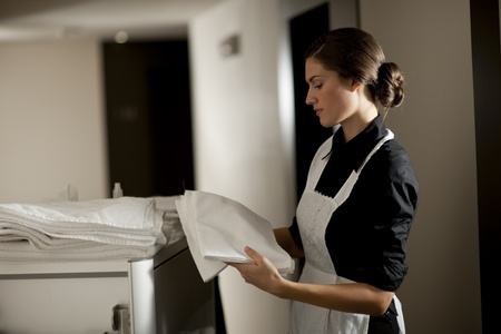 Maid with housekeeping cart Stock Photo - 9319552