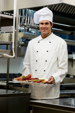 Portrait of a male chef in the restaurant photo