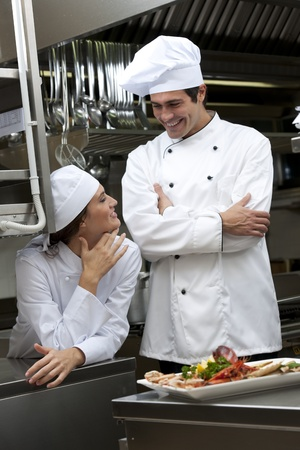 Two Cooks speaking in the kitchen photo