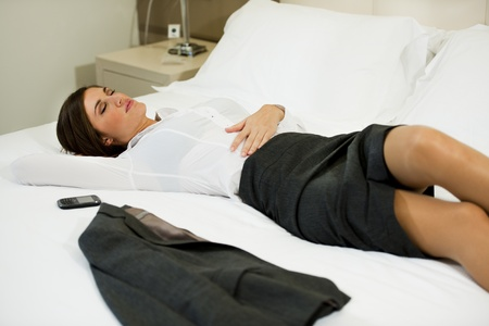 Tired Businesswoman In Hotel Room Stock Photo - 9741074