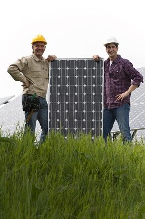 Technicians installing solar panels photo