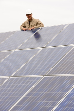 low energy: Working On Solar Panels Stock Photo