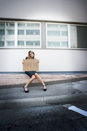 Unemployed Young Woman Asking For A Job photo