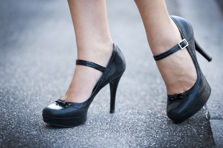 Female legs and high heels shoes photo