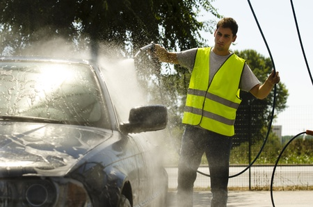 Young man working at car wash station Stock Photo - 12967825
