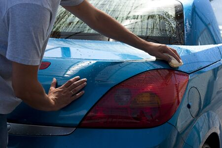 Close-up of a man cleaning his car photo