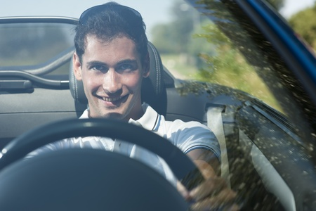 man front view: Front view of a young man driving his convertible car Stock Photo