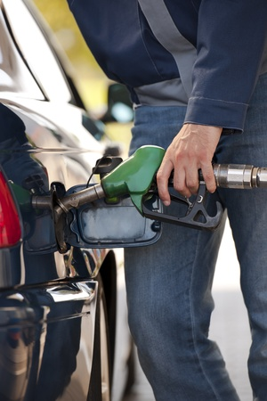 Service station worker filling up car with fuel Stock Photo - 13022168
