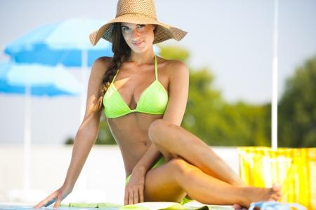 swimmingpool: Beautiful young woman at swimming-pool Stock Photo