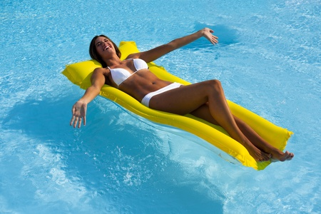 matress: Happy Beautiful woman relaxing and floating on pool, high angle view Stock Photo