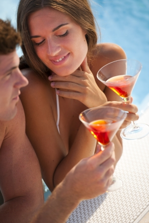 Close-up of a happy couple having drink photo