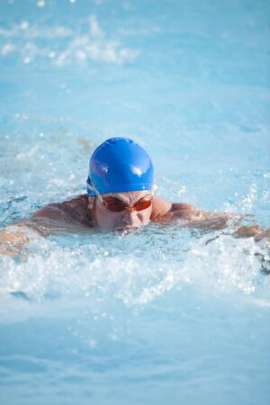 Competitive male swimmer photo
