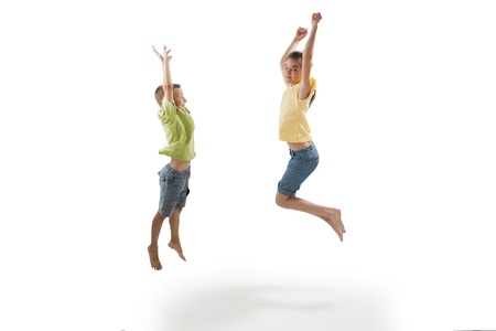 Two children jumping, white background photo