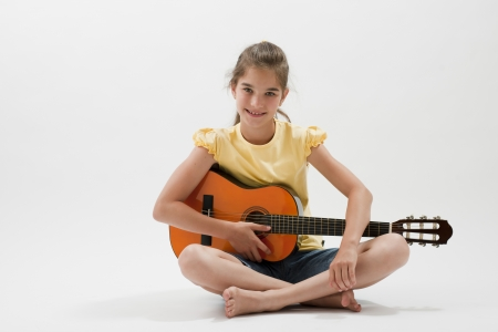 only girls: Little girl posing with guitar