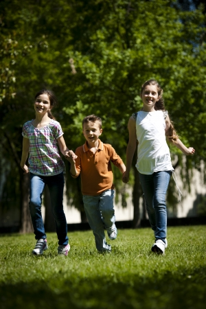Children running in the park photo