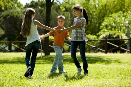 Small group of children playing ring-around-the-rosy Stock Photo - 15455435
