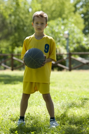 boy basketball: Portrait of a little boy holding a basketball Stock Photo