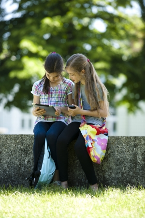 palmtop: Little friends with PC tablet and mobile phone Stock Photo