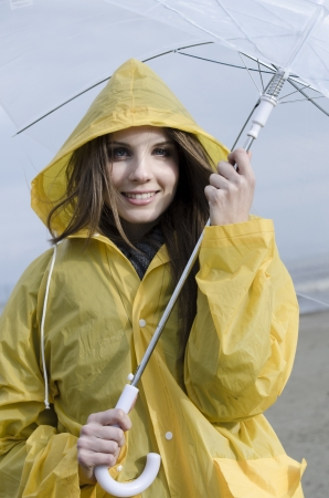 yellow jacket: Young woman enjoying a rainy day