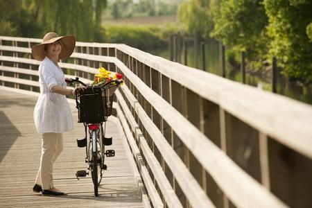 walling: Woman with bike