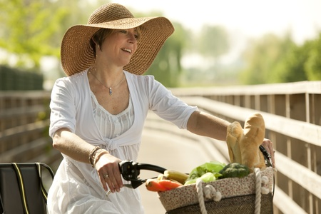 walling: Woman cicyling with vegetables on her basket
