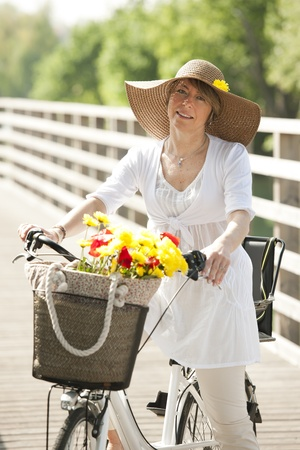 walling: Woman on her bike, smiling at camera