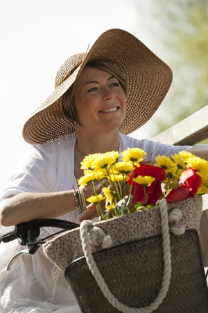 walling: Woman on her bike with colorful flowers