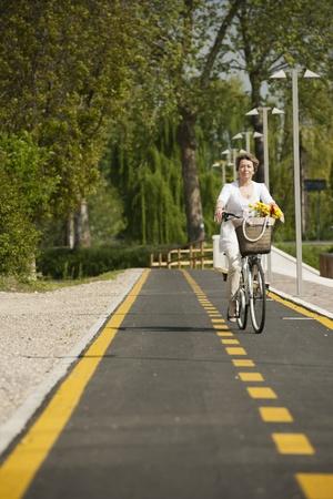 healthy path: Woman biking
