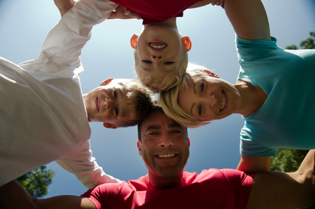 huddling: Happy family embracing, directly below Stock Photo