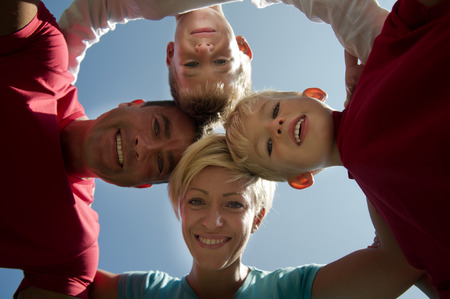 directly below: Happy family embracing, directly below Stock Photo
