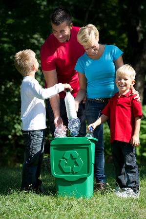 rubbish bin: Go green: hapy family recycling plastic bottles outdoors