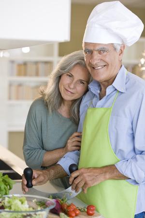 Happy senior couple cooking healthy food photo