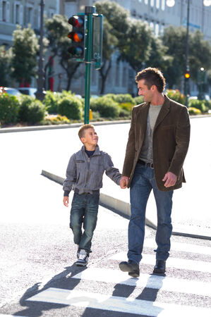 cross walk: Father and son crossing the cross walk Stock Photo