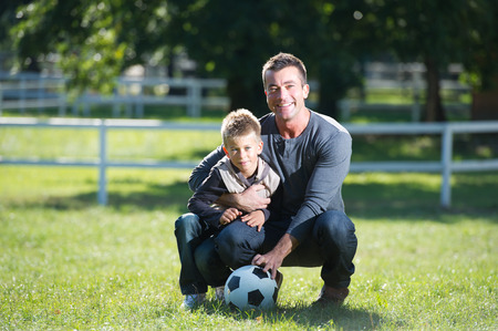 papa: Father and son with football