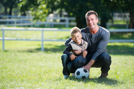 Father and son with football photo