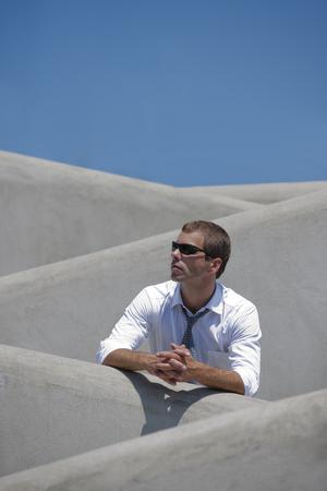 looking sideways: Businessman on a stairs, looking sideways