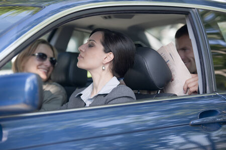 Business people sharing car Stock Photo