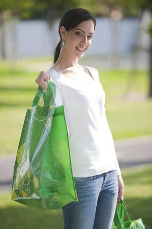 reusable: Beautiful young woman with reusable bags
