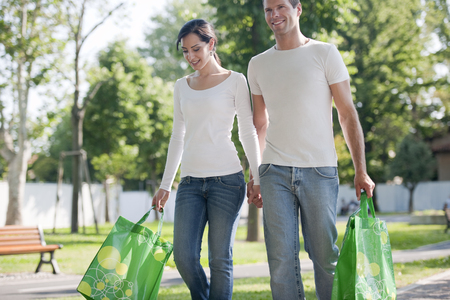 reusable: Young couple with reusable bags