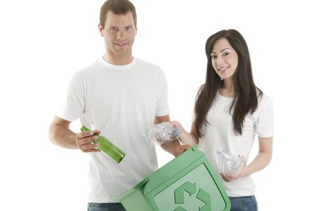 socially: Young couple recycling