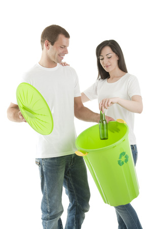Young couple recycling glass bottles Stock Photo
