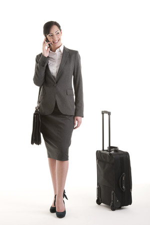 business traveller: Happy business traveller eon the phone Stock Photo
