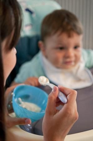 heaving: Cute baby heaving yogurt